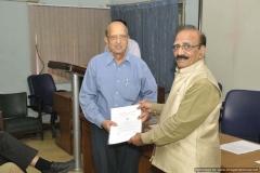 Dr R G Sharma Felicitating Dr R K Luthra on joining 80+ fraternity